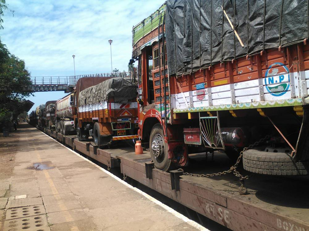 Trucks loaded on train
